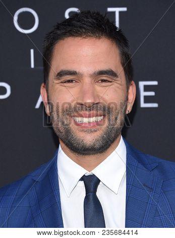 LOS ANGELES - APR 09:  Ignacio Serricchio arrives to the premiere of Netflix's