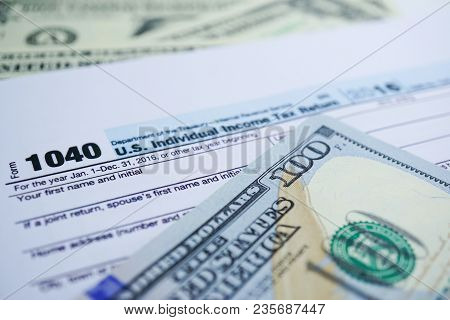 Tax Return Form 1040 And Dollar Banknote : U.s. Individual Income.