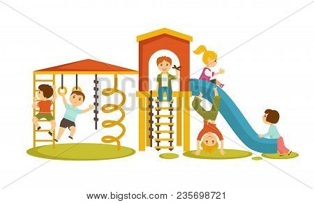 Children Have Fun At Playground With Big Slide And Many Ladders To Climb. Little Funny Girls And Boy