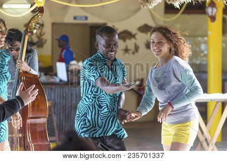 Havana, Cuba - January 06, 2018: A Professional Dancer Invites A Tourist To The Salsa Dance In A Caf