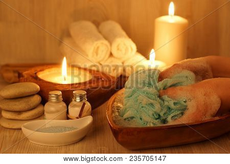 Washing Hands, With A Blue Sponge In The Spa Salon With Burning Candles.