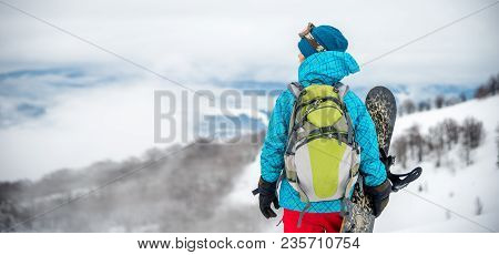 Snowboarder Girl Standing Hold Snowboard In The Mountains