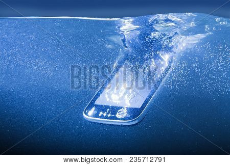 Modern Smartphone Closeup Thrown Into Water Photo