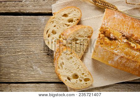Ciabatta Bread. Slices Of Ciabatta On A Wooden Table On Linen Cloth. Rustic, Rustic Style. Top View,