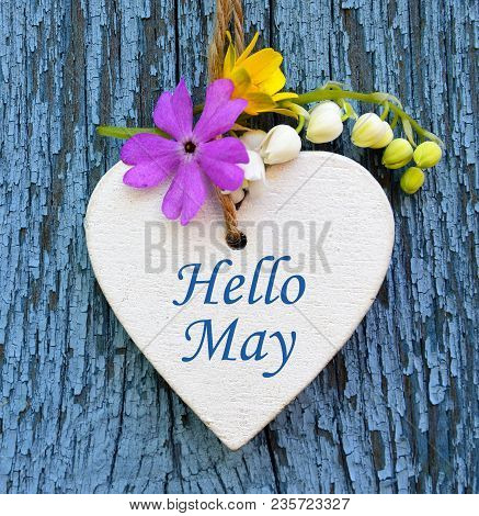 Hello May Greeting Card With Decorative White Heart And Spring Flowers On Old Blue Wooden Background
