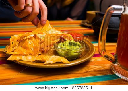 Nachos Chips From Mexican Cuisine With Sauces On The Table