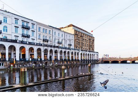 Historic Buildings With Arcade At Alster Lake In Hamburg, Germany On Sunny Day