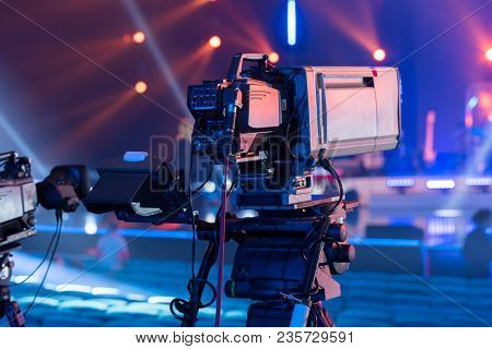 Professional Tv Camera With A Large Lens On The Tripod During The Recording Of The Concert