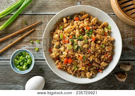 Delicious Chicken Fried Rice With Egg, Carrot, Garlic And Green Onion.