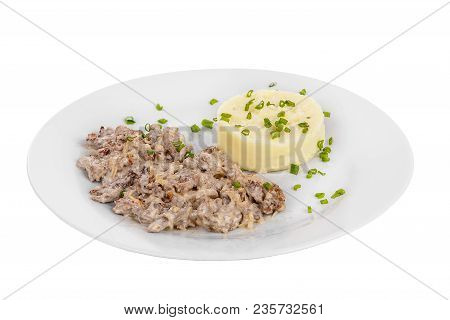 Frikasse From Beef, Pork, Lamb Meat With Side Dish Mash Potato, Green Onions On A Plate Isolated Whi