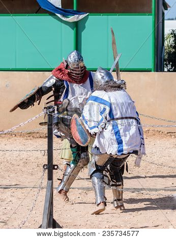 Goren, Israel, April 06, 2018 : Two Knights - Participants In The Knight Festival Are Fighting On Th