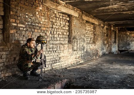 A Thoughtful Soldier, Resting From A Military Operation Location Of Ruins