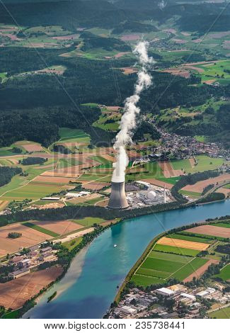 Cooling Tower Near The River. Vapour Goes Out From Cooling Tower. An Aerial View From Plane. Portrai