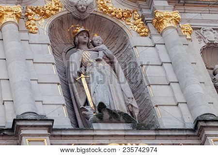 Leuven, Belgium - September 05, 2014: Sculpture On The Facade Of The Library Building Of The Catholi