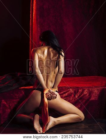 Love, Woman With Tied Hand In Bedroom. Dominance And Submission, Woman. Bdsm, Naked Girl In Red Room