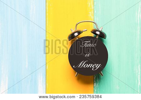 Time Is Money Black Alarm Clock On The Colorful Backgrounds With Wording Time Is Money