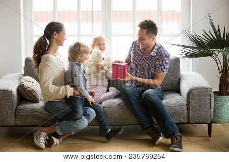 Receiving Present On Fathers Day Concept, Wife And Kids Congratulating Happy Smiling Dad Opening Gif