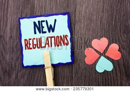 Handwriting Text Writing New Regulations. Concept Meaning Change Of Laws Rules Corporate Standards S