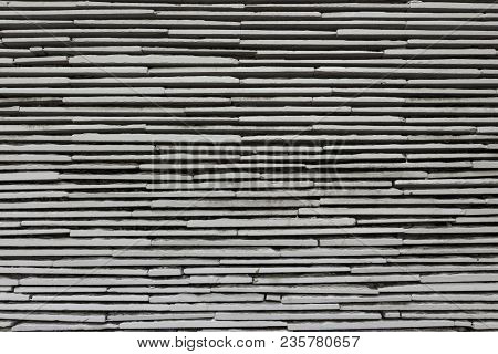 Pattern And Detail Of Design Mix Stone Wall Background In Nature Light