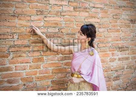 Women Stand Wearing Traditional Cloth Thailand Or Thai Dress With Ancient Walls Background