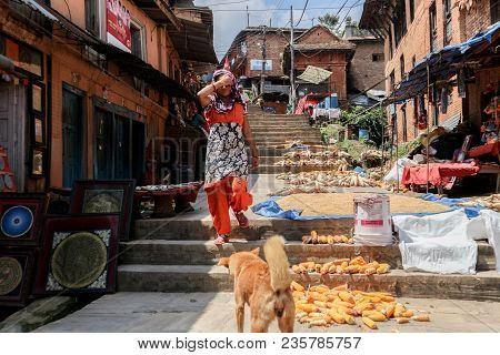 Kathmandu, Nepal - September 22, 2016: Nepalese Woman Dress Walking Down The Steps On The Street Wit