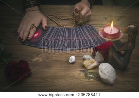 Tarot Cards On The Table. Fortune Teller Reading The Future And Holds In Hands A Rosary Beads. Futur