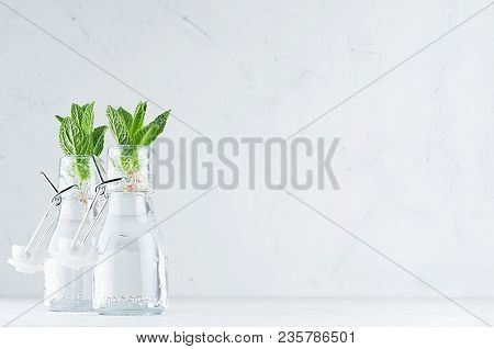 Green Young Mint Leaves In Bottle With Mineral Water On Soft White Wood Board. Summer Background, Co