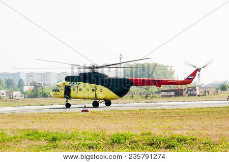 Tyumen, Russia - August 11, 2012: On A Visit At Utair Airshow In Plehanovo Heliport. Rescuers Load I