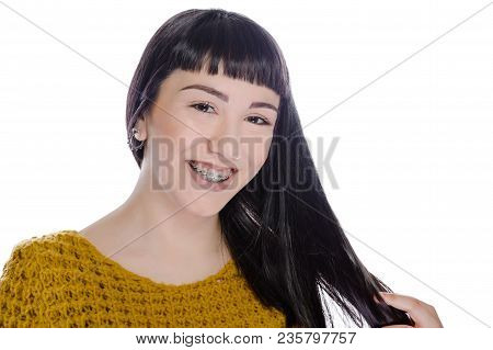 Cute Teenager With White Background, Wearing Braces On His Teeth.
