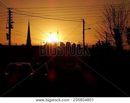 Sunrise Town Silhouette With Cars And Breaking Lights