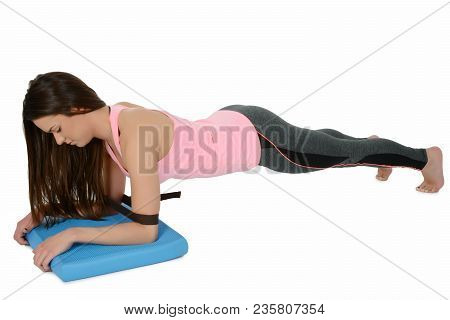 Chaturanga Dandasana -four-limbed Staff Pose Variation With Yoga Props - (belt Or Block) A Young Whi