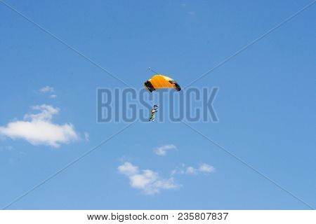 Colorful Parachute In The Clear Blue Summer Sky Extreme Air Entertainments.
