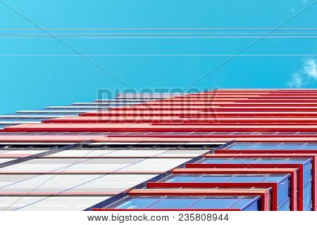 A colorful abstract ground view of the top of a skyscraper with blue sky. Copy space.