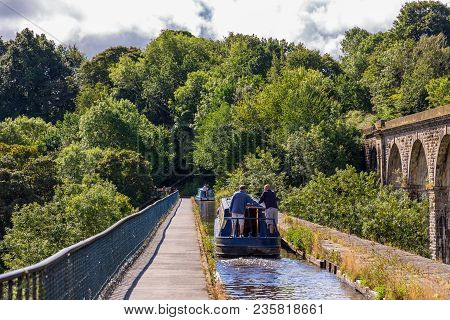 Chirk, Wrexham, Wales, Uk - August 31, 2016: Narrowboats With People Steering Over The Chirk Aqueduc