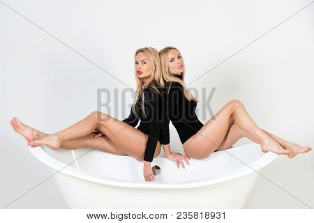 Relax, Spa, Bathroom, Bodycare. Twin Women In Bath, Relations. Family, Sisters Girls In Bathroom. Tw