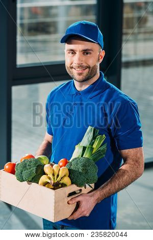 Delivery Man Holding Box With Fresh Groceries