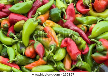 Red And Green Fresh Peppers At The Local Market
