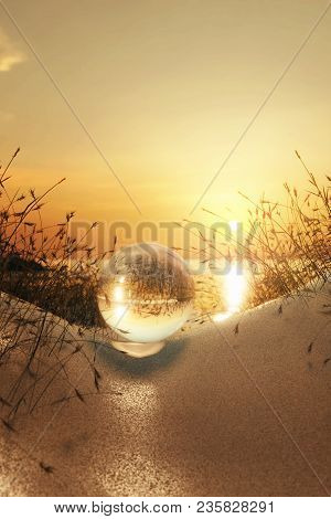 3d Rendering Of Cristal Ball In Front Of Sunset On The Coastline