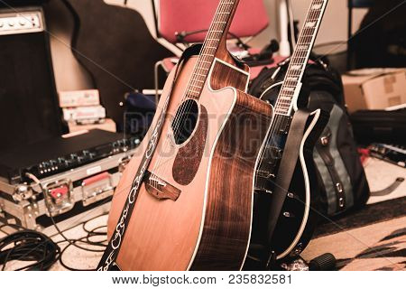 Acoustic And Electric Guitars In A Messy Recording Studio Area.
