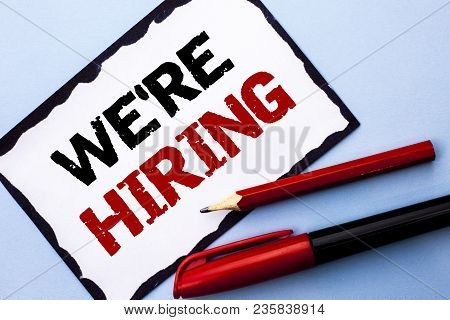 Conceptual Hand Writing Showing We're Hiring. Business Photo Text Recruiting Hiring Now Recruitment