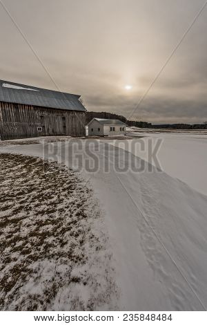 Old Barn, Small House, Drifted Snow, Sunlight Reflected On The Roof,  And Interesting Clouds...perfe