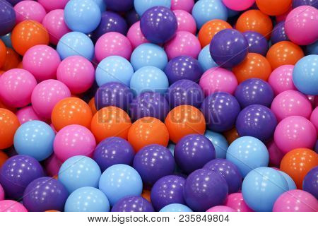 Colorful Child Balls. Multi-colored Plastic Balls. A Children's Playroom. Background Texture Of Mult