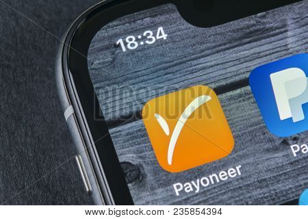 Sankt-petersburg, Russia, April 12, 2018: Payoneer Application Icon On Apple Iphone X Smartphone Scr