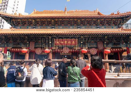 Hong Kong, China - March 19, 2018: Local Chinese Hong Kong People Standing Pay Respect And Praying T