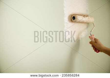 Hand Painting Wall With Paint Roller, Pastel Color. Appartment Renovation, Repair, Building And Home