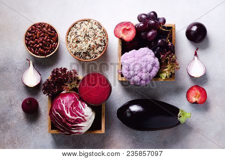 Purple Vegetables, Fruits On Grey Background. Violet Eggplant, Beets,  Cauliflower, Purple