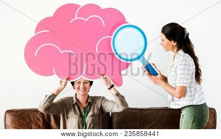 Women holding pink cloud icons