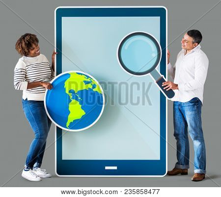 Diverse couple holding a tablet