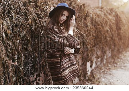 Fashion shot. Stylish young woman in boho clothes in a city. Ethnics, boho style.