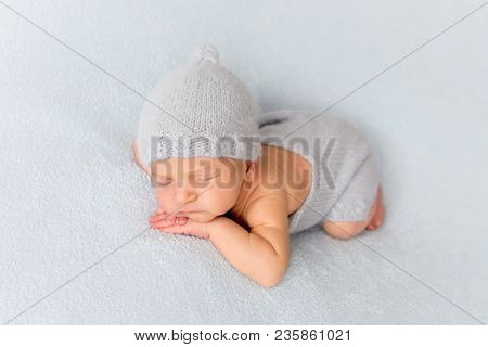 Tender newborn sleeping on belly